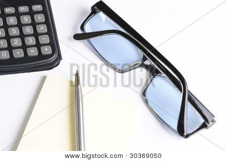 Calculator With Pen And Glasses On A White Background