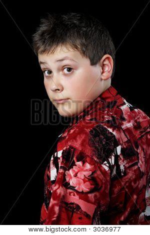 3036977 Stock Photo   Young teen boy smoking near graffiti wall.