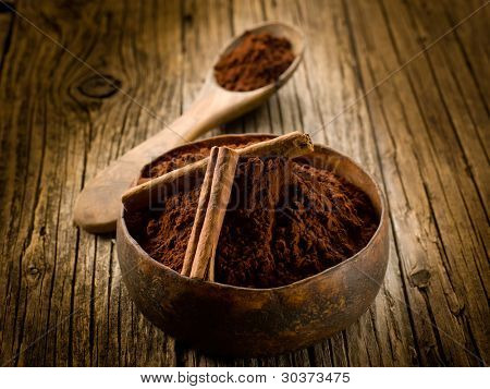cacao powder with cinnamon on wood bowl