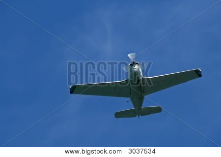 Lone Stunt Plane Flying Through The Sky