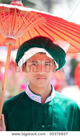 CHIANG MAI, THAILAND - FEBRUARY 4: Traditionally dressed man portrait in procession on Chiang Mai 36th Flower Festival on February 4, 2012 in Chiang Mai, Thailand