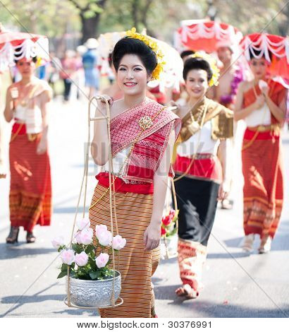 CHIANG MAI, THAILAND - FEBRUARY 4: Traditionally dressed girls in procession on Chiang Mai 36th Flower Festival on February 4, 2012 in Chiang Mai, Thailand