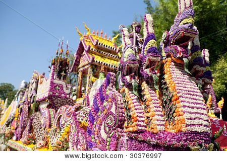 CHIANG MAI, THAILAND - FEBRUARY 4: Traditionally decorated floral float in procession on Chiang Mai 36th Flower Festival on February 4, 2012 in Chiang Mai, Thailand