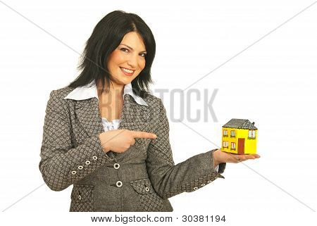 Happy Real Estate Woman Pointing
