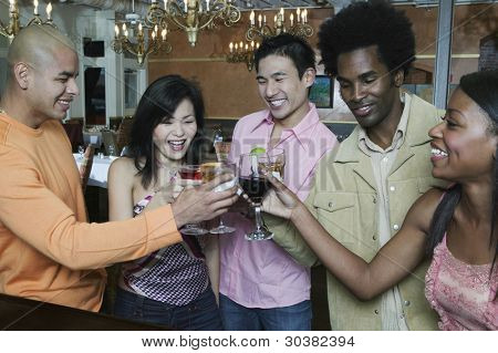 Friends toasting each other