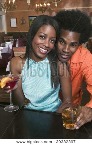Portrait of couple drinking at bar