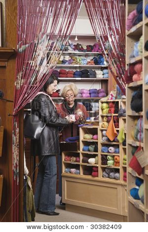 Two women in yarn shop