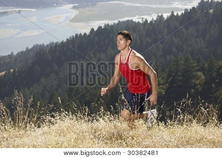 Male running on mountain trail