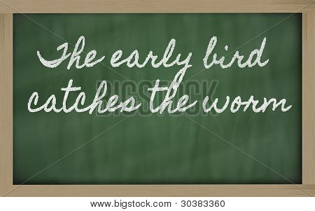 Expression -  The Early Bird Catches The Worm - Written On A School Blackboard With Chalk