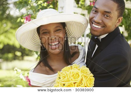 Portrait of happy bride and groom