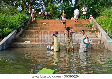 Central Sri Lanka, December 4, 2012. Peasants Are Cleaning On The Shore Of An Ancient Artificial Lak