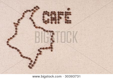 Coffee Beans On Canvas In The Shape Of Colombia And Cafe