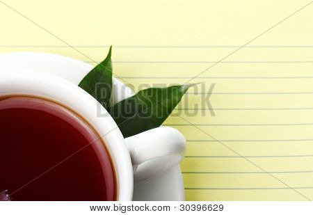Cup of hot tea and notebook