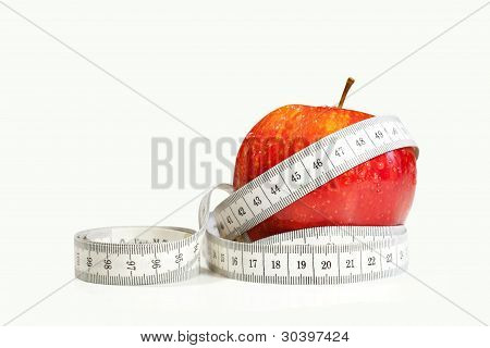 Red apple with tape measure