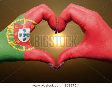 Heart And Love Gesture By Hands Colored In Portugal Flag During Beautiful Sunrise