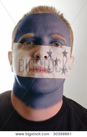 Face Of Serious Patriot Man Painted In Colors Of Honduras Flag