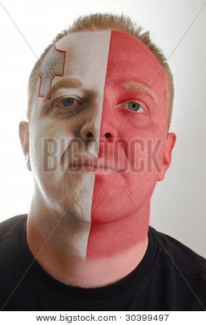 Face Of Serious Patriot Man Painted In Colors Of Malta Flag