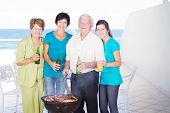 foto of braai  - family barbecue on balcony with sea view background - JPG