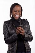 stock photo of young black woman  - Gorgeous young South African woman reading a surprising message on her phone - JPG