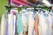 Few Elegant Wedding, Bridesmaid ,evening, Ball Gown Or Prom Dresses On A Hanger In A Bridal Shop. Fa poster