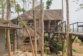 Wood Exterior House Design In Country Style Side View. Exterior House Among Natural Forest. Country  poster
