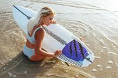 Surf Girl With Long Hair Go To Surfing. Young Surfer Woman Holding Blank White Short Surfboard On A  poster