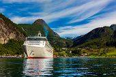 Cruise Ship, Cruise Liners On Geiranger fjord, Norway. The fjord is one of Norways most visited tou poster