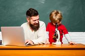Elementary School Teacher And Student In Classroom. Daddy Play With Schoolboy. Teacher And Schoolboy poster