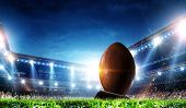 Full night football arena in lights poster