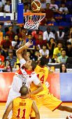 KUALA LUMPUR - FEBRUARY 19:Slingers Donald Little (14) and Dragons Brian Williams (33) rebound for t