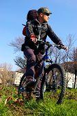 image of sakhalin  - Man on bicycle travels on city - JPG