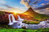 Morning landscape with rising sun on Kirkjufellsfoss waterfall and Kirkjufell mountain, Iceland, Eur poster