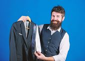 Shop Assistant Or Personal Stylist Service. Matching Necktie Outfit. Man Bearded Hipster Hold Neckti poster