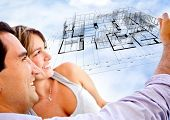 stock photo of propose  - Couple with the blueprints of their dream house - JPG