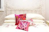 stock photo of femenine  - Detail of girly bed decor in retro bedroom - JPG