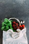 Reusable Bag With Groceries. Tote Bag, Minimal Waste. Fresh Basil, Tomatoes Cherry, Garlic In Fabric poster