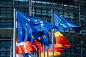 Close-up Of Flags Of All Member States Of The European Union Waving In Calm Wind In Front Of The Par poster
