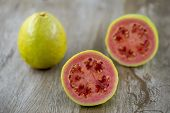 Sliced ​​guava On Wooden Surface With Space For Text. Typical Brazilian Fruit Used In Vitamins And N poster