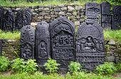 stock photo of bharata-natyam  - Ancient indian god of art represented in black stone - JPG