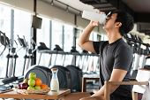 Handsome Man Drinking Protein Shake Milk And Many Kind Of Fruits For Nourishing Body Daily. People L poster