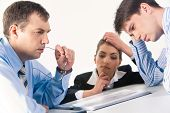 picture of young men  - Image of three professionals thinking about business - JPG