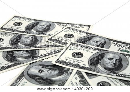 heap of dollar banknotes on a white background