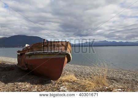 Boat Run Aground In A Beach At Fagnano Lake