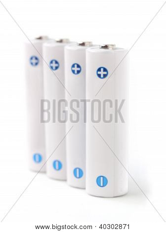 White Rechargeable Aa Batteries On White Background Showing Positive(plus) And Negative(minus) Signs