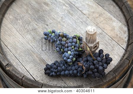 Grapes On Top Of A Wooden Barrel