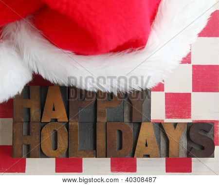 Santa Claus hat with happy holidays words