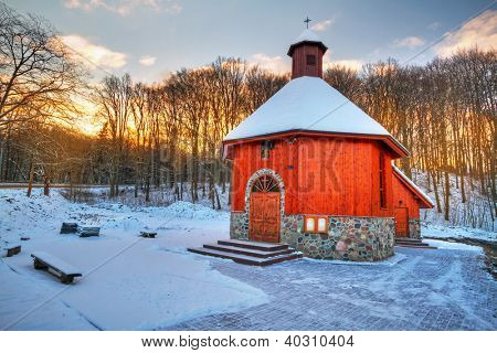 Small cottage church in winter scenery, Poland