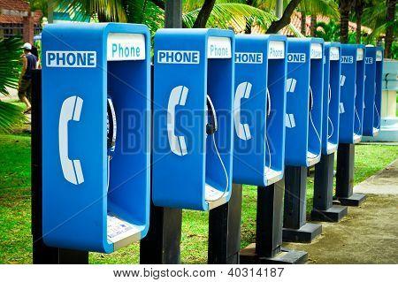 Blue Public Phone In A Row