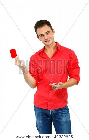 attractive friendly smiling confident young man showing red card in hand, over white background