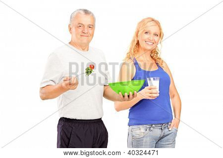 Two mature persons consuming healthy products isolated against white background